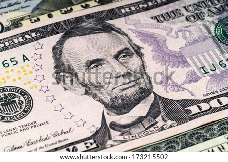 Portrait of Lincoln in front of the dollar bill - stock photo