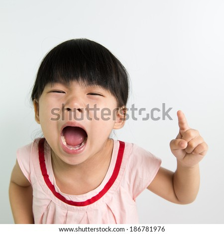 Portrait of little Asian child with silly face