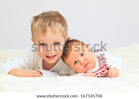 portrait of little boy with newborn sister, family concept - stock photo