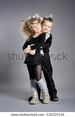 portrait of little boys and girls in the studio in a Christmas style - stock photo
