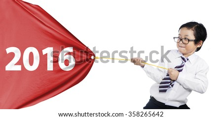 Portrait of little businessman pulling a big flag with numbers 2016, isolated on white background - stock photo