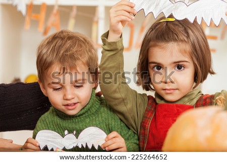 Portrait of  little children having fun for Halloween - stock photo