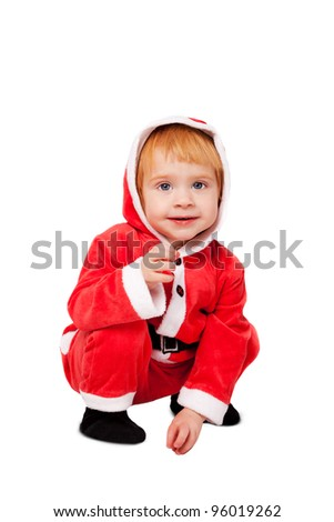 Portrait of little cute baby in red suite of Santa  isolated over white