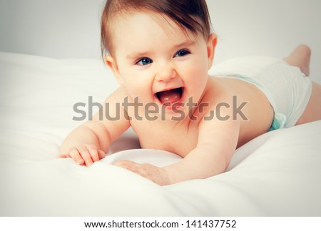 Portrait of little cute baby on a white background - stock photo