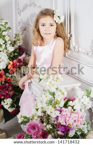 Portrait of little cute girl with flowers