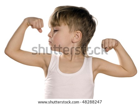 Portrait of little european boy flexing biceps. Beautiful caucasian model. Isolated on white background. - stock photo