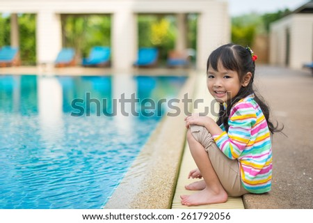 portrait of  little girl at pool - stock photo