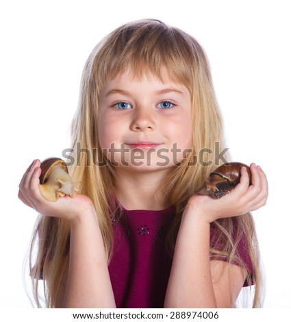 Portrait of little girl holding snails in hands. Isolated on the white background