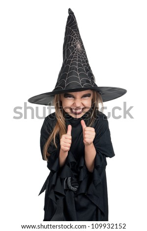 Portrait of little girl in black hat and black clothing with pumpkin on white background - stock photo