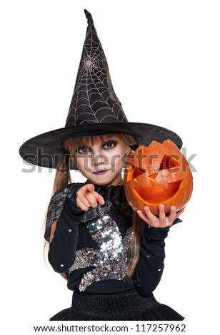 Portrait of little girl in black hat with pumpkin isolated on white background - stock photo
