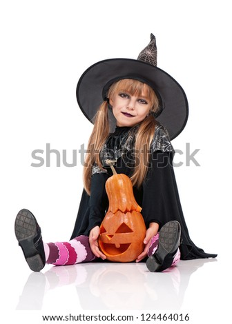Portrait of little girl in black hat with pumpkin isolated on white background