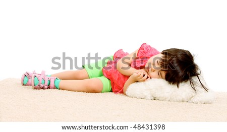 Portrait of little girl in casual clothing sleeping - stock photo