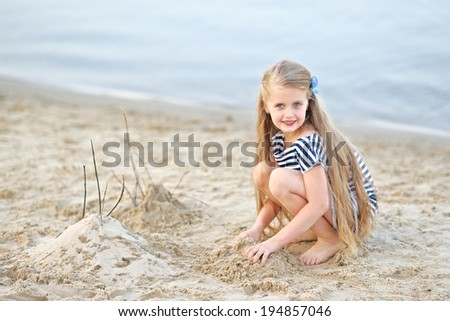 portrait of little girl on a summer beach - stock photo