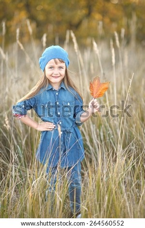 portrait of little girl outdoors in autumn - stock photo