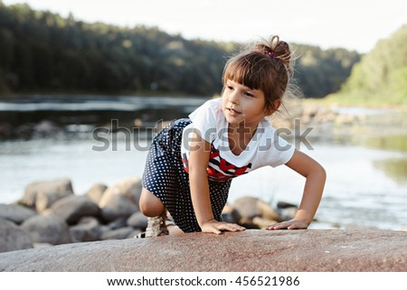 portrait of little girl outdoors in summer. summer portrait of a little girl by the river.