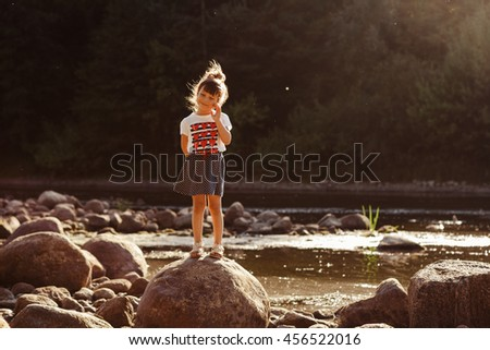 portrait of little girl outdoors in summer. summer portrait of a little girl by the river. - stock photo