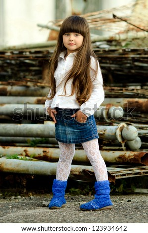 portrait of little girl outdoors in white shirt - stock photo
