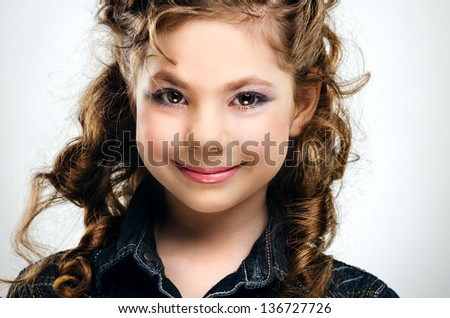 Portrait of little girl over gray background