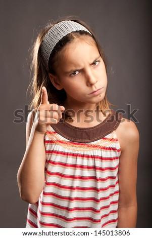 portrait of little girl quarreling - stock photo