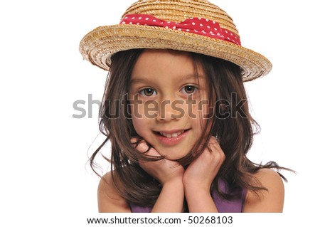 Portrait of little girl wearing a hat ans smiling isolated on a white background
