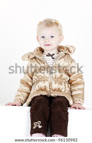 portrait of little girl wearing jacket - stock photo