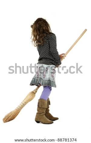 portrait of little girl with a broom,side view - stock photo