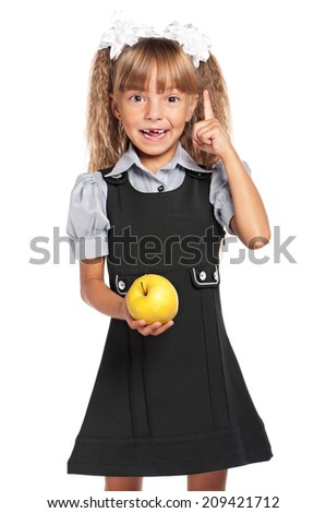 Portrait of little girl with apple isolated on white background - stock photo
