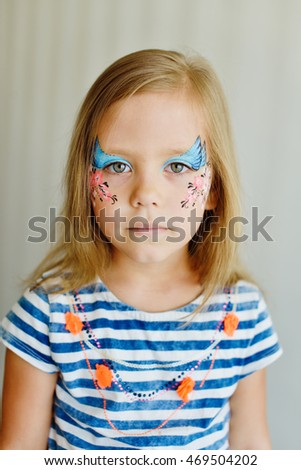 portrait of little girl with aqua makeup