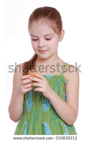 Portrait of little girl with Easter egg isolated over white background - stock photo