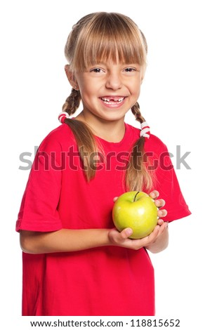 Portrait of little girl with green apple isolated on white background - stock photo