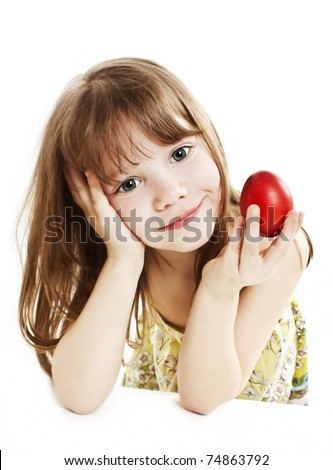 Portrait of little girl with red Easter egg