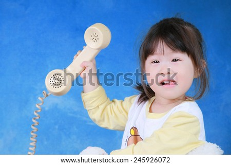Portrait of little girl with retro phone - stock photo
