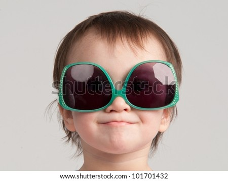 Portrait of little girl with sunglasses - stock photo