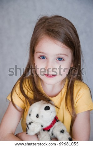 portrait of little girl with toy dog