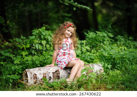 Portrait of Little pretty girl in the green garden  - stock photo