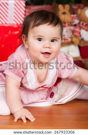 Portrait of little smiling baby girl. Studio shot - stock photo