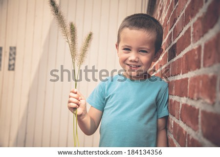 Portrait of little smiling boy outdoors - stock photo