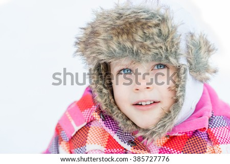 Portrait of Little toddler girl in winter clothes - winter fun
