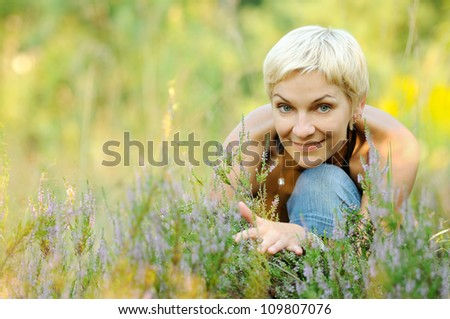 portrait of look well smiling middle aged woman outdoors - stock photo