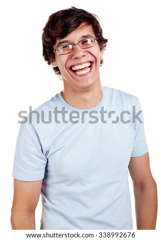 Portrait of loudly laughing young hispanic man wearing glasses and blue t-shirt isolated on white background - laughter concept