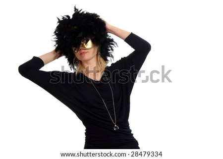 Portrait of lovely blond model posing with golden carnival mask and a black boa on her head. Isolated on white background. - stock photo