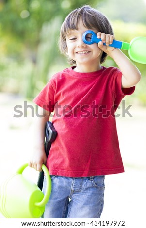 Portrait of Lovely Boy Enjoying Outdoors, Boy Playing - stock photo