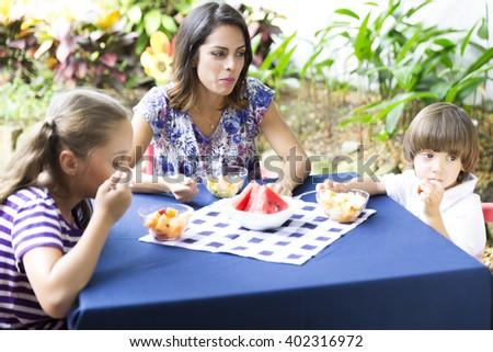 Portrait of Lovely Family Having Picnic - stock photo