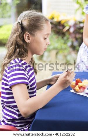 Portrait of Lovely Girl Having Picnic - stock photo