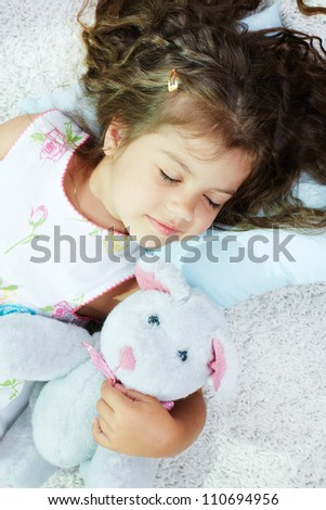 Portrait of lovely girl sleeping with teddybear - stock photo