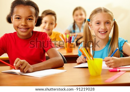 Portrait of lovely girls looking at camera at lesson