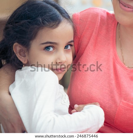 Portrait of lovely hispanic mother and daughter - stock photo