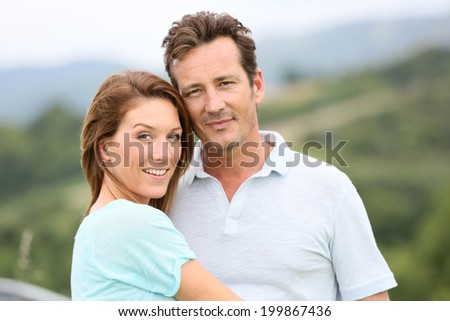 Portrait of loving couple in countryside - stock photo