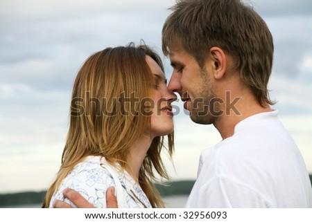 Portrait of loving couple on a sky background - stock photo