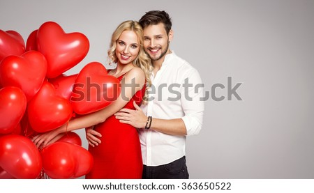 Portrait of loving couple with balloons. Valentine's photo - stock photo